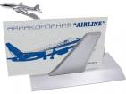 Подставка под визитки с парящим авиалайнером